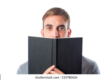 Man holds book and peeks over it isolated on white background