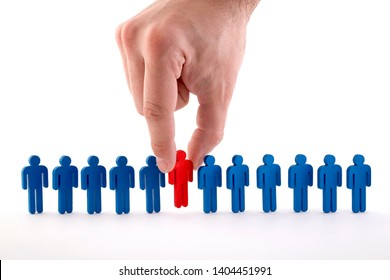 Man holds an employee in his hand. Personnel selection and management within the team. Dismissal and hiring people to work concept.