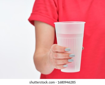 Man holds a glass of water in his hand