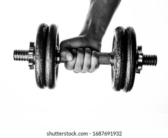 man holds hand a dumbbell on a white background
