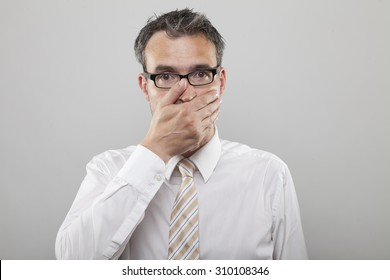Man holds his hand to his mouth due to sickness