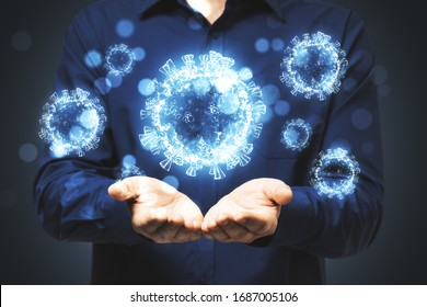 Man holds in his hands blue virus cells. Concept of coronavirus. Healthcare and immunology.