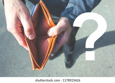 A man holds in his hands and shows a wallet without money, question mark image, retro toned
