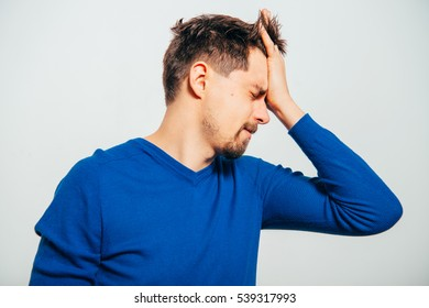 man holds his head