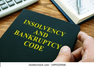 Man holds Insolvency and bankruptcy code IBC.