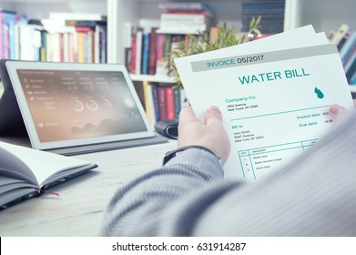 Man holds invoice of water usage