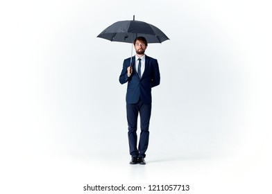 man holds open umbrella in his hand