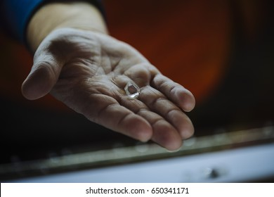 A man holds a rough uncut diamond in northern Quebec on Wednesday, October 19, 2016.