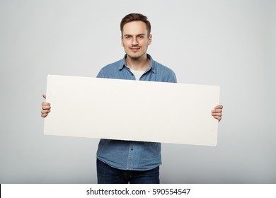 man holds the white sign in a studio white background