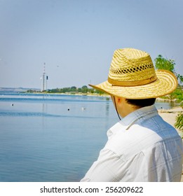Man at holidays rest at sunny day seaside.