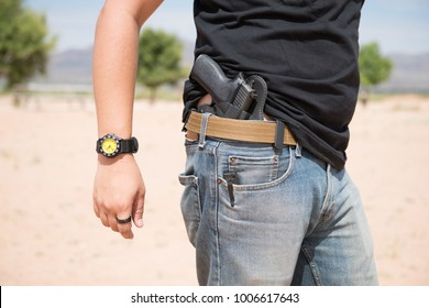 Man with holster pistol in jeans