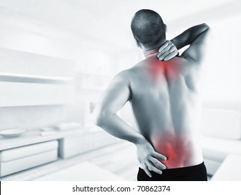 man at home with back pain in red zone