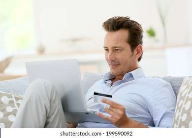 Man at home buying on internet