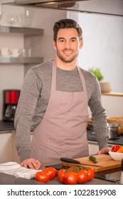 man in home kitchen preparing pasta dish