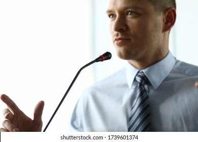 Man at home speaks in front microphone in video. Oratory training during quarantine. Remote training personnel in self-isolation. Video conference confidence senior employees company