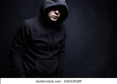 Man in Hood. Boy in a hooded sweatshirt. Fashion portrait