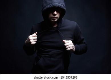 Man in Hood. Boy in a hooded sweatshirt. Fashion portrait