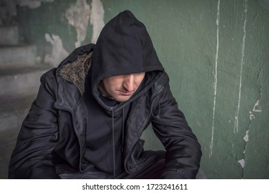 Man in the hood experiencing a drug addiction crisis. Unemployed