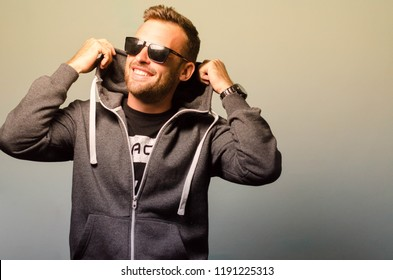 Man a hood and in sunglasses