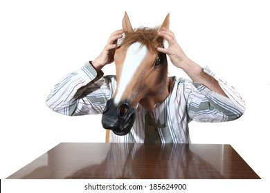 man with a horse's head mask