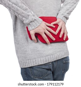 man with hot bottle and back pain