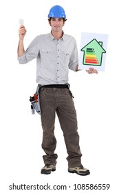 Man with a house energy rating sign and a lightbulb