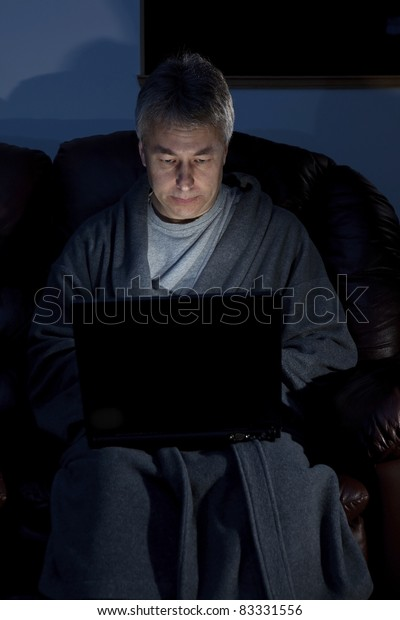 Man in housecoat working late series serious