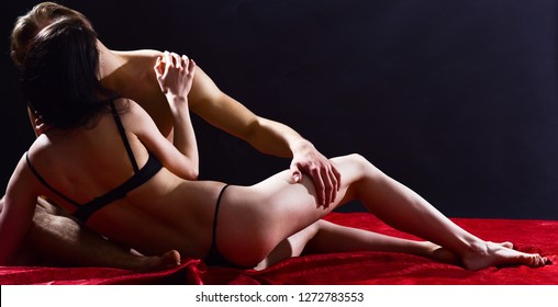 Man hug sexual girlfriend naked buttocks. Couple intimate atmosphere. Lover and sexy naked female body foreplay in bed. Foreplay and sex game. Sex and love concept. Couple make love have sex.
