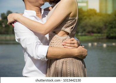 man hug woman in park, couple kiss together. love valentine day concept.