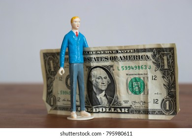 Man with huge dollar bill. Big money or savings concept. Little guy wins or earns big. Business or startup with dreams of wealth. Financial goals met by saving each dollar.