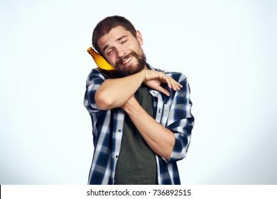 man hugging a bottle of beer on a light background