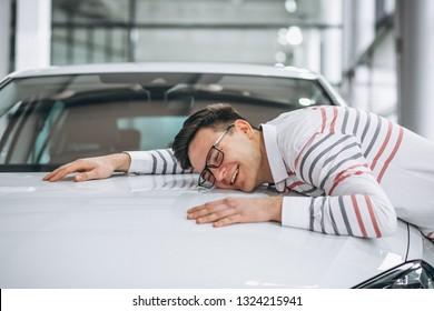 Man hugging a car