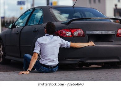 A man is hugging his car