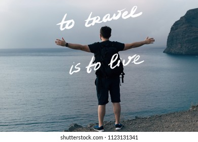 Man hugging the ocean. To travel is to live concept
