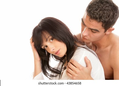 Man hugging pensive woman isolated on white background