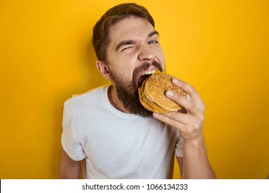 man hungry eating a hamburger