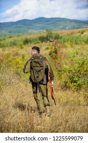Man hunter carry rifle nature background. Experience and practice lends success hunting. Hunting season. Guy hunting nature environment. Masculine hobby activity. Hunting weapon gun or rifle.