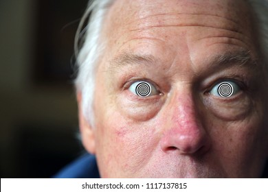 Man with Hypnotic Eyes. A man stares at you with his Hypnotic Eyes, soon you will be Hypnotized. Hypnosis.
