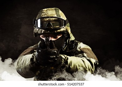 The man in the image of a member of the special forces with weapons