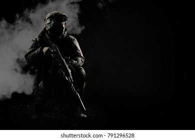 The man in the image of a member of the SWAT police with weapons