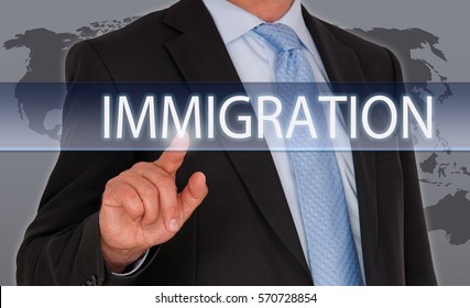 Man with Immigration touchscreen and world map background