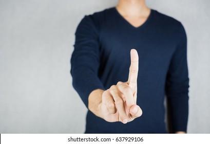 Man index finger gesture, wearing long-sleeved shirt, no face on grey background