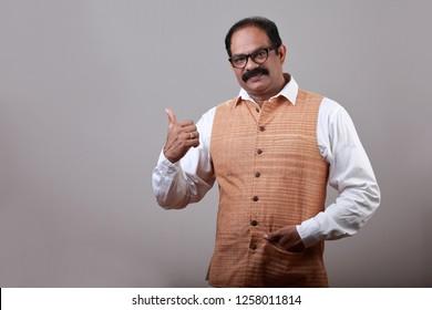 Man of Indian origin shows thumbs up gesture