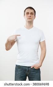 Man indicating himself, white background