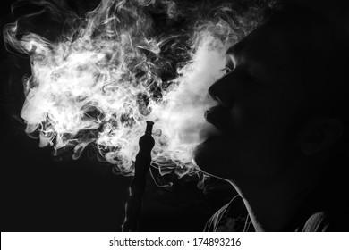 Man Inhaling from a Hookah