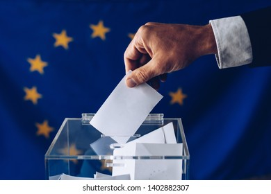 Man inserting his vote to ballot box. European Union elections