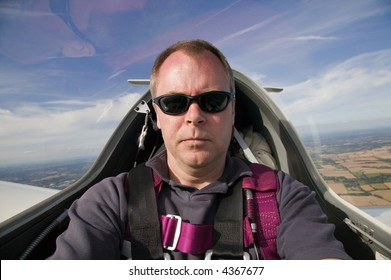 Man inside the cockpit of a glider at 3000 feet.