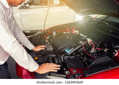 Man inspection holding Battery Capacity Tester Voltmeter.for service  maintenance of industrial to engine repair.In Factory transport automobile automotive image