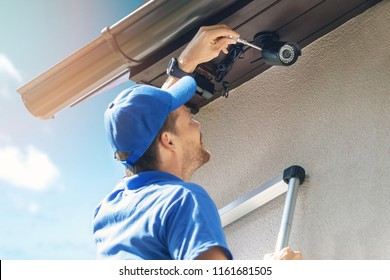 man install outdoor surveillance ip camera for home security
