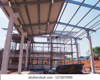 Man install roof on top of building during construction power plant.
